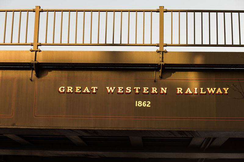 Great Western Railway, Dec 17 GWR Great Western Railway Sunlight Close-up Communication Day England English Golden Hour No People Photooftheday Public Transportation Rail Transportation Railway Sunlight And Shadow Text Train - Vehicle Transportation Uk