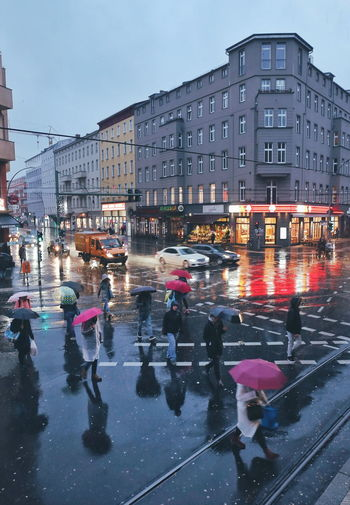 Rainy Days Mobility In Mega Cities City Street City Architecture Building Exterior Outdoors Winter City Life Wet Cityscape Large Group Of People People