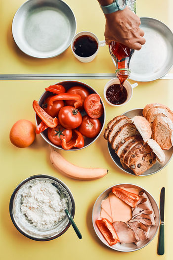Breakfast prepared during summer vacation on camping. bread, cottage cheese, cold meat, tomatoes