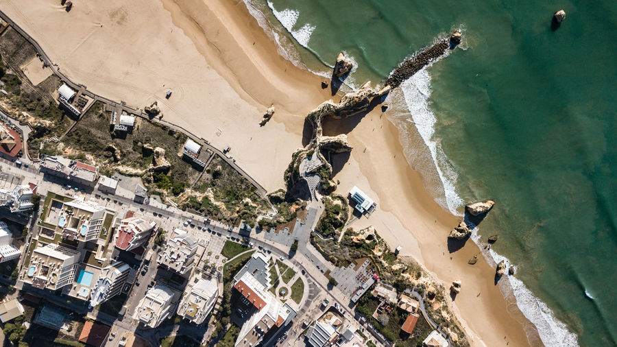 Aerial View Of City By Beach