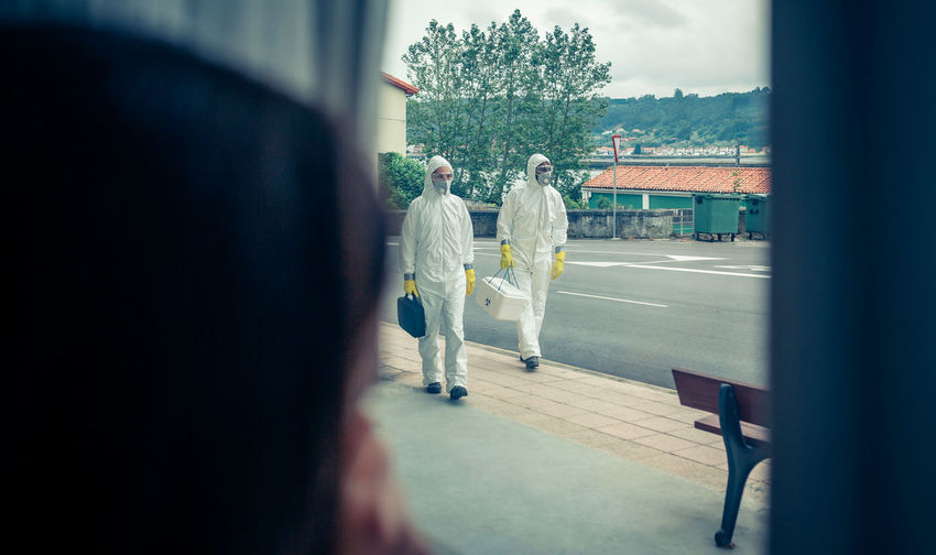Doctors walking on footpath in city