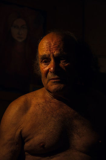Portrait One Person Adult Senior Adult Indoors  Headshot Shirtless Black Background Dark Contemplation Looking At Camera Studio Shot Wrinkled Mature Adult Looking Males  Front View Waist Up Chest Semi-dress Human Face