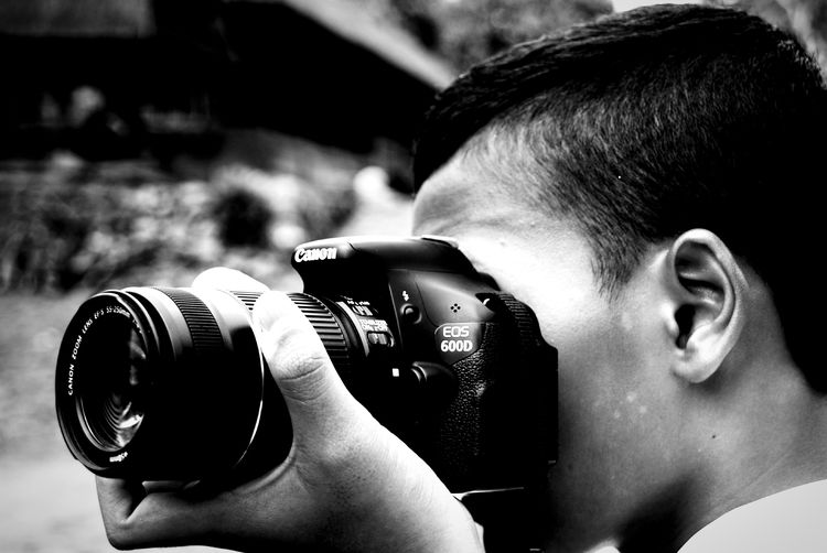 Monochrome Photography Headshot Photography Themes Camera - Photographic Equipment Headshot Photography Themes Camera - Photographic Equipment One Person People Person Portrait Adult Close-up Arts Culture And Entertainment Horizontal Real People Day Outdoors Young Adult One Man Only