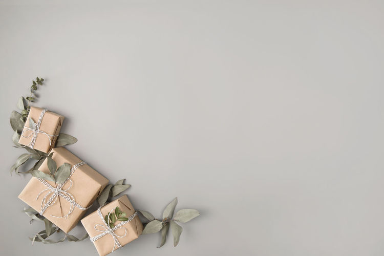 High angle view of paper in box against white background