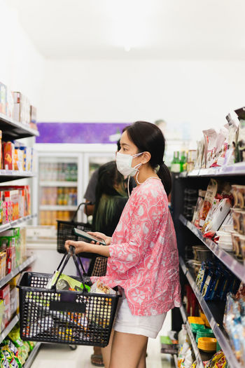 Full length of woman standing at store