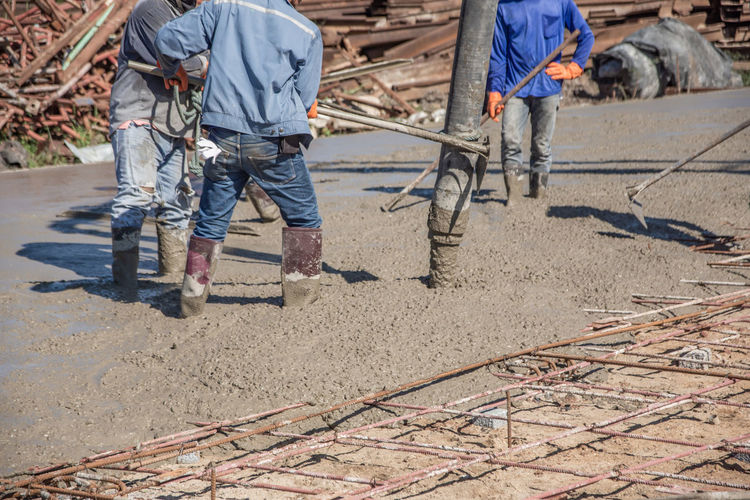 Construction Industry Working Men Construction Site Construction Worker Industry Concrete Mixing Ready Reinforcement Pouring Plasterers Site Cement Liquid Equipment Foundation Pattern Workers