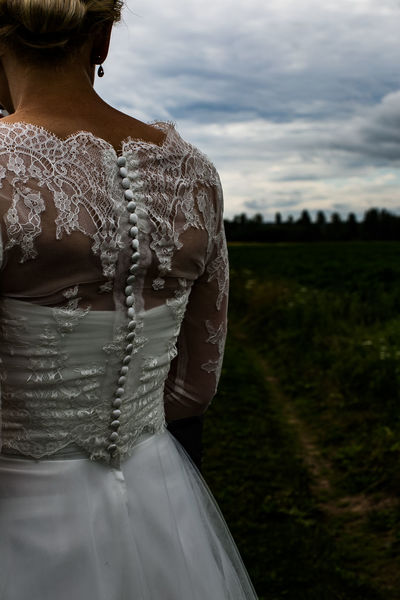 Bottons Dress Romantic Woman Backgrounds Botton Bride Cloth Day Design Designing Field Houte Couture Lace Lace - Textile Lifestyles One Person Outdoors Real People Rear View Sky Standing Wedding Dress Women Young Adult