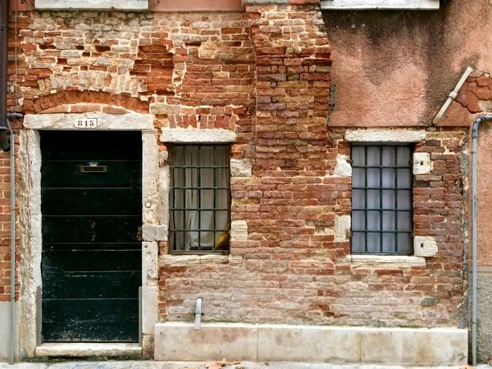 Masks of Venice: Door and Window to a City's Soul - https://youtu.be/ZbwmPbP8H8E Architecture Architecture_collection Brick Wall Doors Masks Streets Of Venice The Week On EyeEm Venezia Venice, Italy Windows To The Soul Architecture Brick Wall Bricks Building Exterior Built Structure Door Doors And Windows Doors And Windows Around The World Doors With Stories Structures & Lines Window Windows Windows And Doors Windows_aroundtheworld