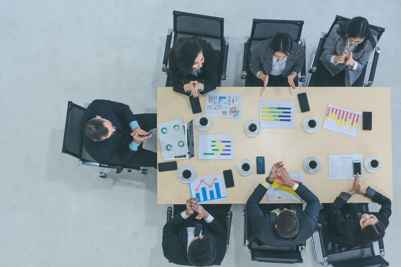 High angle view of business people discussing in office