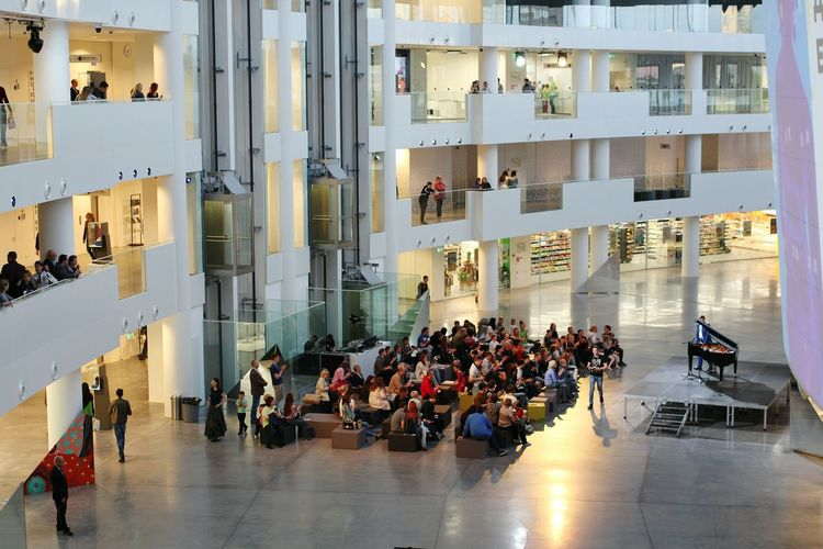 People Sitting Architecture Day Office Building Exterior Urban Geometry Urban Indoors  Large Group Of People Waiting