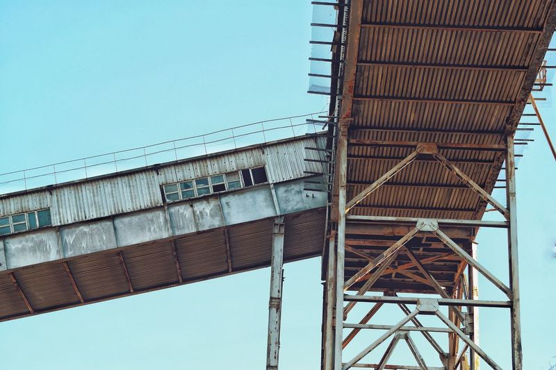 Low Angle View Built Structure Sky Architecture Day No People Nature Metal Blue Bridge - Man Made Structure Outdoors Construction Industry Building Exterior Industry Clear Sky Bridge Construction Site Connection Development