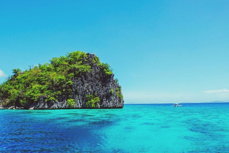 Done That. Sea Blue Scenics Beauty In Nature Water Nature Clear Sky Turquoise Colored Tranquil Scene Horizon Over Water Outdoors Copy Space Day Idyllic Sky Rock - Object No People Travel Destinations Tree