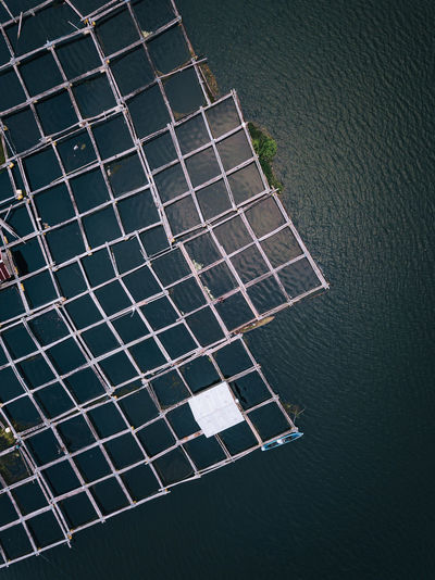 A local Balinese fishing structure sits in the middle of a large lake. One fisherman paddles out in a small kayak to check the structure and cast a fishing line. Aerial Shot Bali Drone  INDONESIA Abstract Aerial View Drone Photography Fish Mavic Pro Sunset Week On Eyeem The Great Outdoors - 2018 EyeEm Awards The Traveler - 2018 EyeEm Awards The Architect - 2018 EyeEm Awards A New Perspective On Life Capture Tomorrow