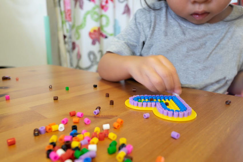 Childhood Child Leisure Activity Multi Colored Table Indoors  One Person Females Girl Kids Playing Toy Selective Focus Home Interior Innocence Heart Shape Beads Colours Plate Funny Home Handmade Indoors  Learning