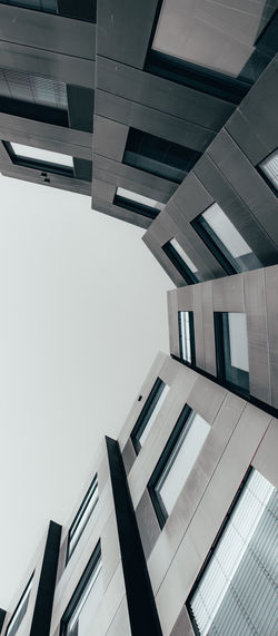 Architecture Built Structure Building Exterior Building Low Angle View Office No People City Sky Modern Glass - Material Office Building Exterior Window Tall - High Outdoors Business Directly Below Gray Depressing Lines, Shapes And Curves