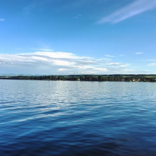 Bergpanorama Water Sky Outdoors Tranquility Waterfront Blue Scenics Tranquil Scene Cloud - Sky Sea Architecture Nature Built Structure Rippled Beauty In Nature No People Day Building Exterior Vacations Nautical Vessel Bodensee Bodenseebilder Seeufer