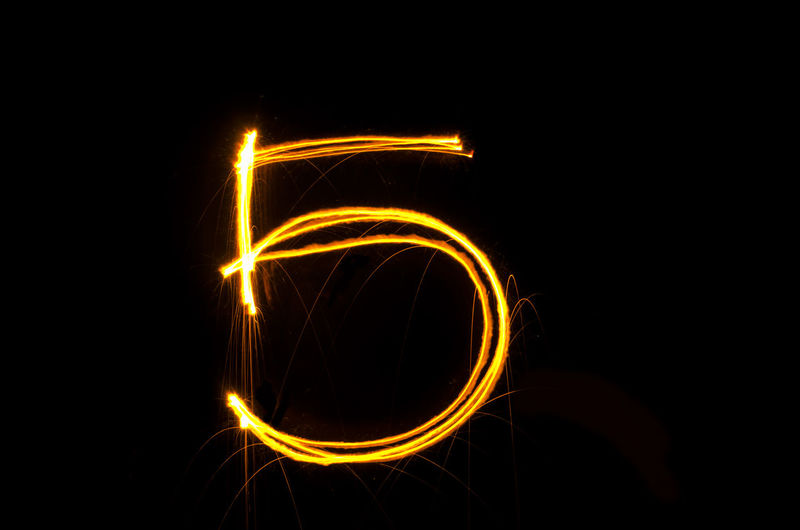 Number 5 made with light painting against black background