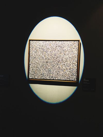 Close-up of electric lamp against window
