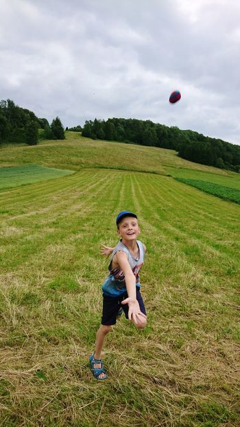 EyeEm Selects Child Children Only Childhood One Person Summer Day Grass Outdoors Nature Baseball Cap Sky Fun Having Fun Smile Smiling Enjoying Life Boy