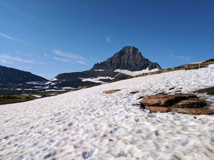 Snow on logan pass on a clear day in glacier national park