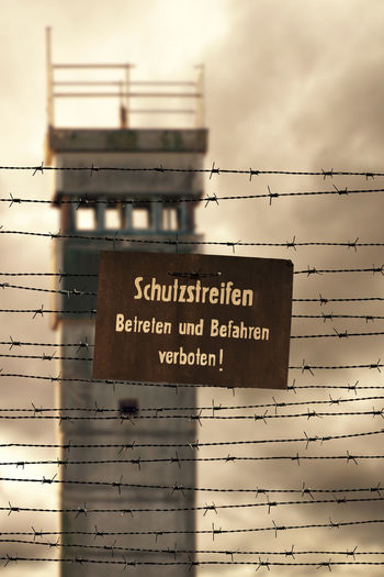 Border Change Communist Day DDR East Germany Fence GDR Germany No People Outdoors Prison Sky Text The Wall Tower Wall Watchtower Wende