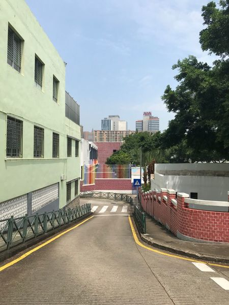 Street view in Macao Building Exterior Built Structure Architecture City Tree Sky Transportation Nature Street Building Road Outdoors The Way Forward Direction Footpath Cloud - Sky No People