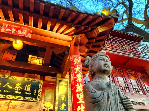Chinese New Year: Tang Dynasty Lady Figure & New Year Well-Wishing Calligraphy Scrolls Architecture Art Art And Craft Artcraft Building Exterior Chinese New Year 2016 Cityscape Culture Cultures Figurine  Human Representation Inscribed Boards IPhone Photography IPhoneography Mobileography New Year Scrolls Here Belongs To Me Pattern Red Scrolls Sculpture Shop Signs Statue Street Photography Tang Dynasty Tradition