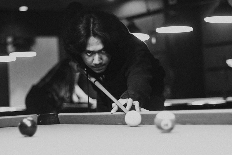 Man playing snooker indoors