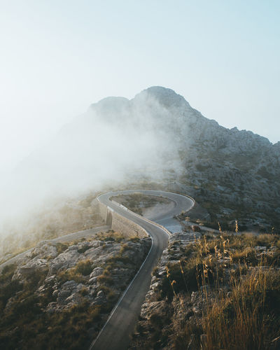 The winding roads of Sa Calobra, Mallorca, Spain. Cloud Mallorca Nature Nature Photography SPAIN Sunlight Beauty In Nature Environment Fog Island Landscape Mountain Mountain Road Nature Nature_collection Naturephotography No People Outdoors Road Scenics - Nature Sky Sun Sunrise Sunset Winding Road
