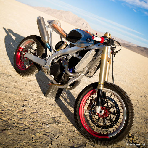 #procrasti racer in the new @sideburnmag & get the full story on this #oneofakind #custom #bike. One of the coolest shootings in the past year in the #blackrock desert on the #burningman grounds. Black Rock Desert Burning Man Custom Desert Drake Mcelr Motorcycle Parked Riding Sideburn Sideburns