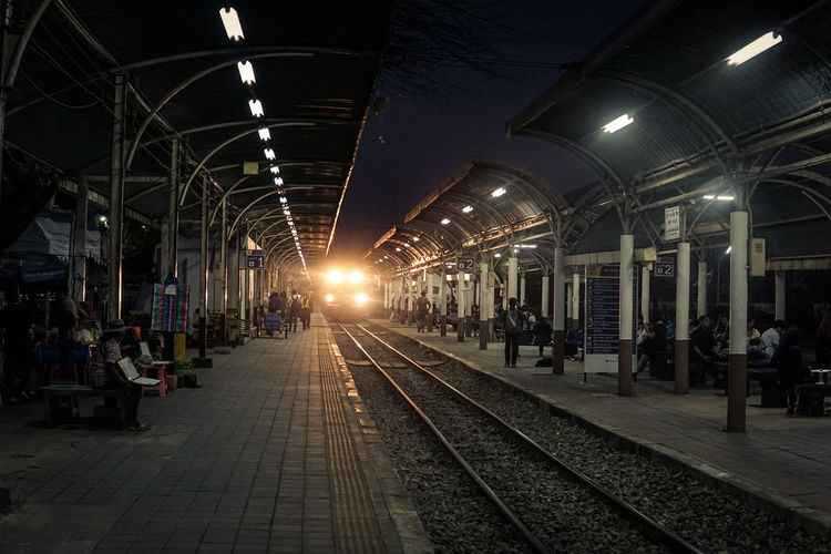 Rail Transportation Railroad Station Platform Night Railroad Station Railroad Track Illuminated Outdoors City Traveling Home For The Holidays Travel Evening View Let's Go. Together.