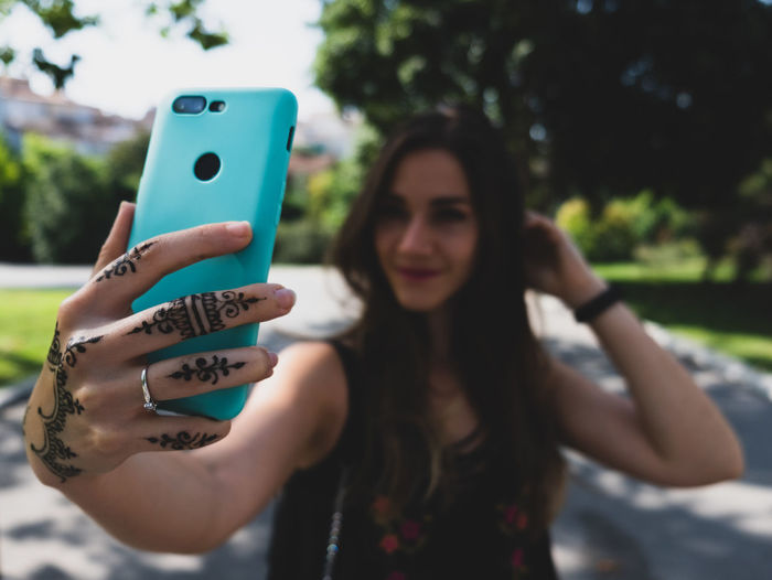 Young woman taking selfie on smart phone