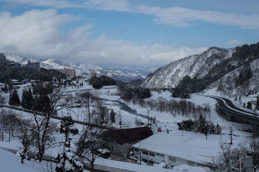 YUZAWA Architecture Beauty In Nature Cloud - Sky Cold Temperature Covering Day Mode Of Transportation Mountain Mountain Range Nature No People Outdoors Plant Scenics - Nature Sky Snow Snowcapped Mountain Tranquil Scene Tranquility Transportation Tree Winter Yuzawa City