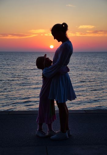 Meaning of Life. Love Mother & Daughter Horizon Over Water Sunset Portrait Togetherness Tranquil Scene Scenics Two People Spirituality Silhouette Sea Tranquility Contour Magic Exceptional Photographs EyeEm Best Shots Light And Shadow Fairytales & Dreams Life Colors Lifeisbeautiful Beauty In Nature Scenery PENTAX K-1