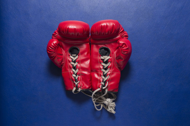 High Angle View Of Red Boxing Gloves On Table