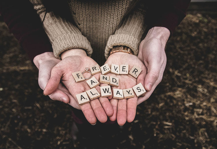 Engagement Wedding Close-up Communication Day Holding Human Hand Men Message One Person Outdoors People Real People Ring Scrabble Text