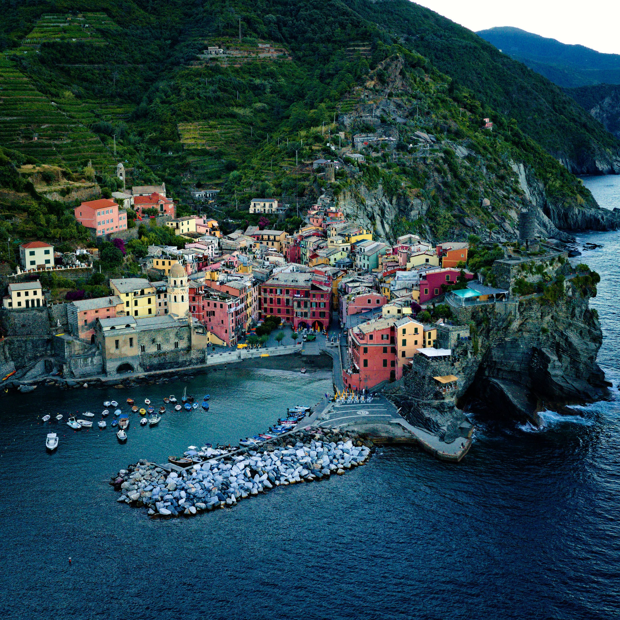 water, architecture, coast, nature, sea, mountain, building exterior, built structure, city, transportation, travel destinations, land, no people, building, bay, nautical vessel, day, travel, high angle view, scenics - nature, outdoors, beauty in nature, beach, harbor, plant, sky, environment, tourism, mode of transportation, coastline, landscape, tree, house