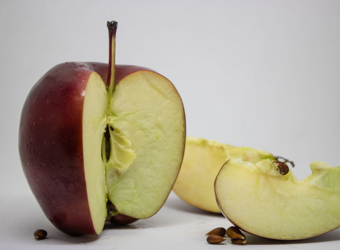 Close-up of apple on table against white background