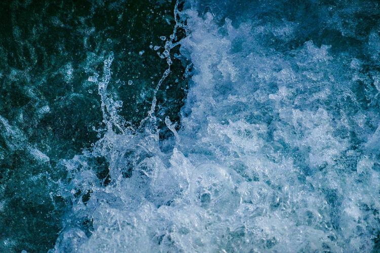 Full frame shot of wave splashing on water