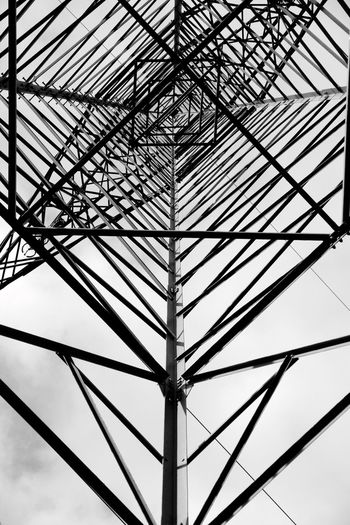 Ironman EyeEmNewHere Low Angle View Lookingup Lines Built Structure Architecture Connection Metal Pattern No People Day Sky Electricity Pylon Complexity Outdoors Ironman Iron Powerpole Electricity