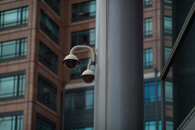 Security cameras against building