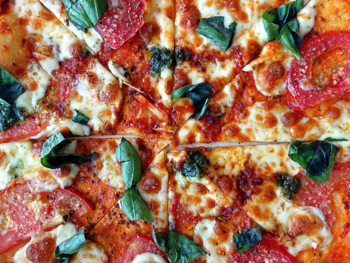 Delicious pizza Margherita with fresh basil, tomato and cheese. Close-up Crisp Food Fresh Basil Freshness Hot Melted Cheese Pizza Margherita Pizza Slice Ready-to-eat Tomato Sauce