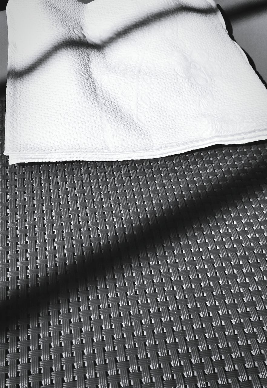 High Angle View Of Towel On Bed
