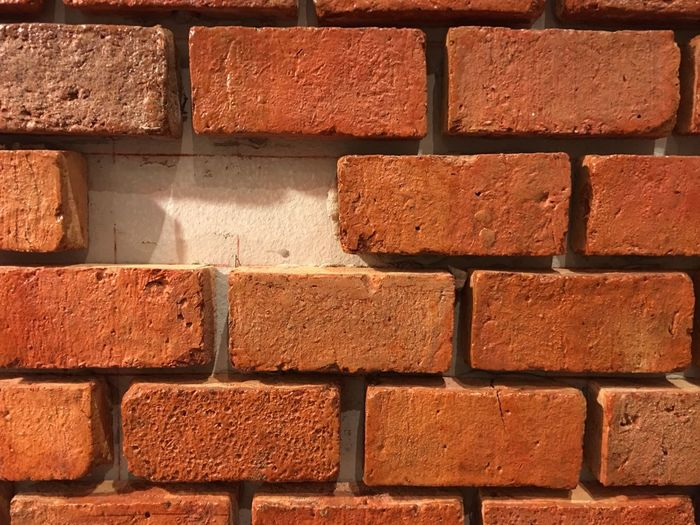 Brick Wall Brick Wall - Building Feature Red Built Structure Backgrounds Architecture Textured  Building Exterior Outdoors No People Day Close-up Different