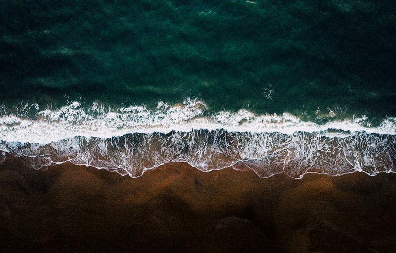 Scenic view of sea waves splashing on land