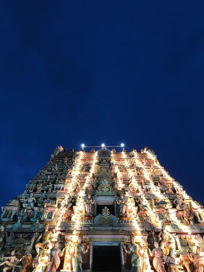 Low angle view of illuminated temple against clear sky at night