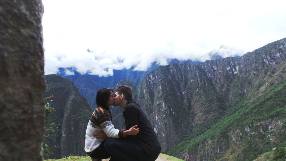 Beauty In Nature Bonding Couple - Relationship Cuzco Day Leisure Activity Love Machu Picchu Men Mountain Nature Outdoors People Peru Real People Romance Sitting Sky Togetherness Tree Two People Warm Clothing Women Young Adult Young Women