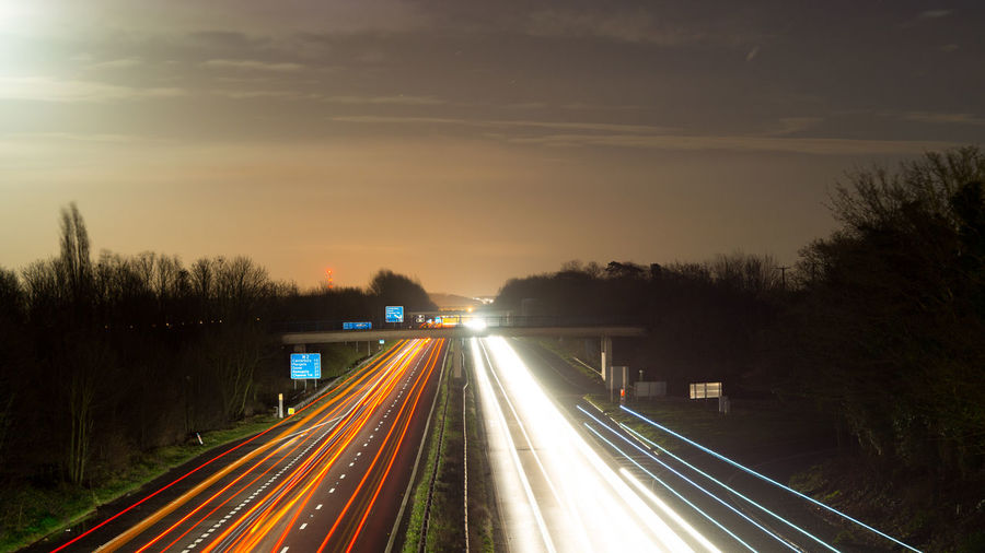 Light Trails On Road Against Sky