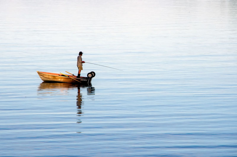 Evening Fishing Water Nautical Vessel One Person Reflection Mode Of Transportation Lake Transportation Day Nature Waterfront Oar Outdoors Tranquility Men Tranquil Scene Beauty In Nature Standing Paddling Rowboat Fishing Baynes Sound Salish Sea
