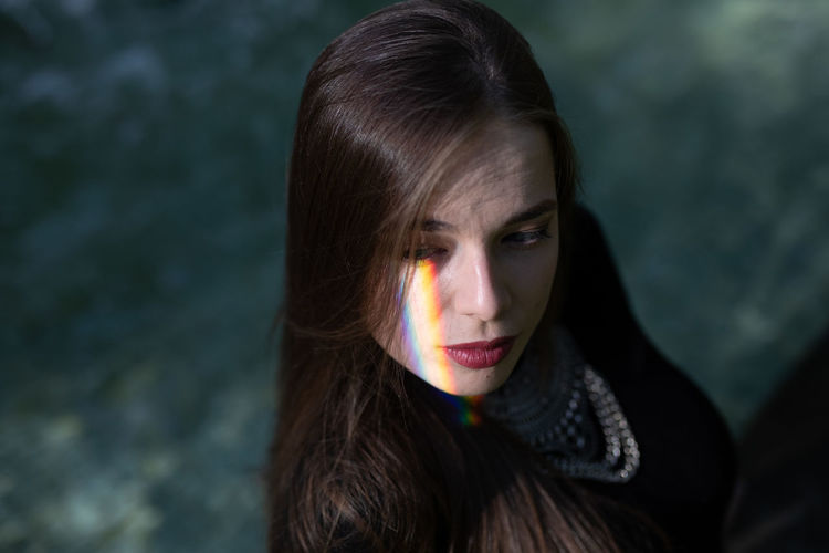 Close-up of young woman with spectrum